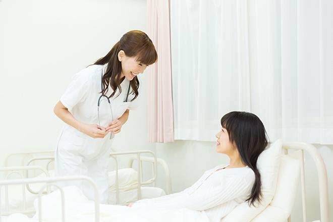 病院のナースと患者